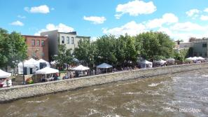River Walk: Vendors set up for the Defeat of Jesse James Days.